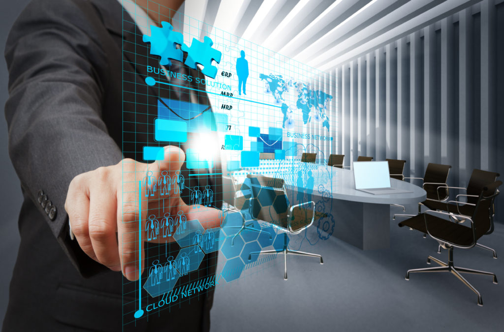 businessman hand point on virtual business network in board room